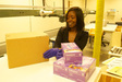 Woman with Gloves and Boxes | Smart Partners Alliance - State Use Program | Indianapolis, IN