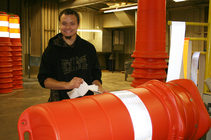 Daniel Gibbs and Large Traffic Cone | Smart Partners Alliance - State Use Program | Indianapolis, IN