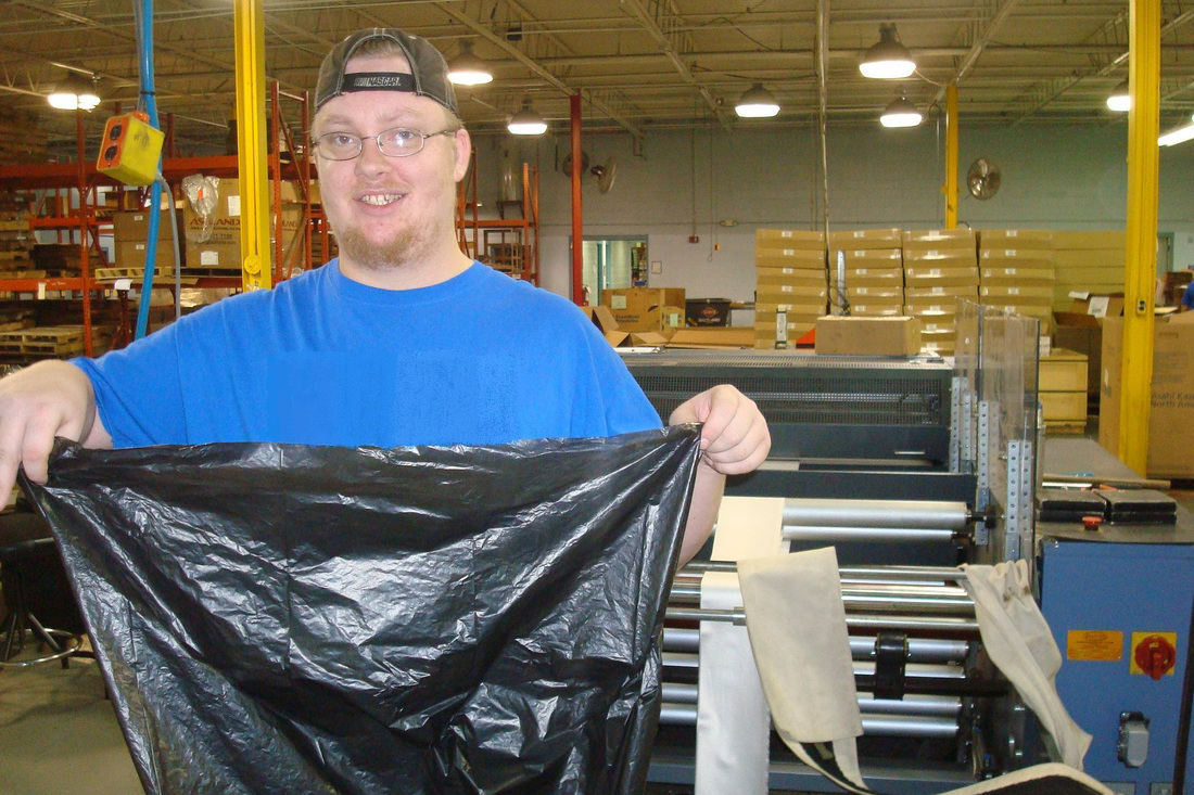 Man with Trash Bag | Smart Partners Alliance - State Use Program | Indianapolis, IN